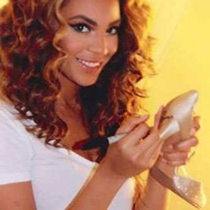 Beyoncé autographing her tour shoes for the charity auction to help Haiti